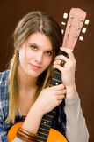 Rock musician - fashion woman holding guitar Royalty Free Stock Photo
