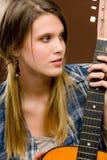 Rock musician - fashion woman holding guitar Royalty Free Stock Photo