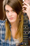 Rock musician - fashion woman holding guitar Stock Image