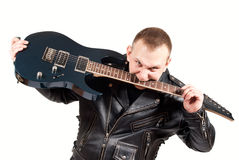 Rock musician with a guitar Stock Image