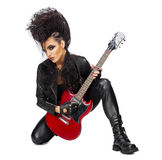 Rock musician with guitar. Rock musician in leather clothing isolated Royalty Free Stock Image