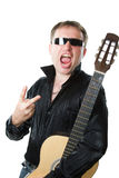 Rock musician, man in glasses with  guitar screams Royalty Free Stock Image