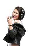 Rock musician with mic and headphones Stock Photography