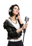 Rock musician with microphone and earphones Stock Images