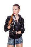 Rock musician with microphone. Young pretty woman dressed like a rock musician with static microphone isolated on white background Royalty Free Stock Photos