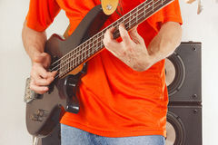 Rock musician playing the bass guitar Royalty Free Stock Image
