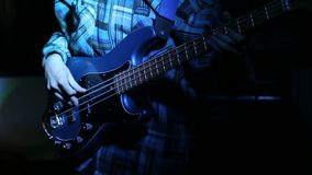 Rock musician playing bass guitar on concert. Close up view stock video