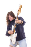 Rock musician playing electric bass guitar. Isolated on white background Stock Images