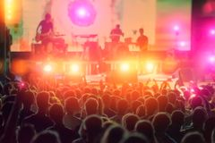 Rock musicians and fans during the performance. Evening rest at a music concert. Web banner stock image