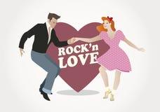 Rock'n爱:英俊的人和别针女孩跳舞晃动 图库摄影