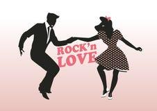 Rock'n爱:英俊的人和别针女孩跳舞晃动 库存图片
