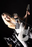 Rock-n-roll with the beautiful blonde Royalty Free Stock Photography