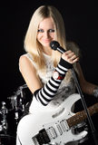 Rock-n-roll with the beautiful blonde Royalty Free Stock Photos