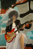 Rock'n Roll bride. Young bride playing electric guitar Royalty Free Stock Photography