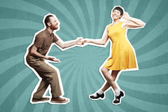 Rock`n`roll dance boogie woogie. Boogie acrobatic stunt in a studio background. Dance for rock-n-roll music Stock Photos