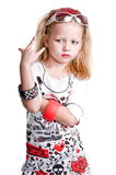 Rock N Roll Dress Up. Young caucasian girl playing rock n roll dress up flashing the rock n roll sign Stock Photo