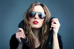 Rock'n'roll girl. Portrait of the girl in sun glasses Stock Photos