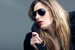 Rock'n'roll girl. Portrait of the girl in sun glasses Royalty Free Stock Image