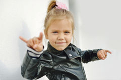 Rock-n-roll girl. Cute little girl making a rock-n-roll sign Royalty Free Stock Photos