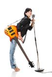 Rock-n-roll girl holding a guitar singing Royalty Free Stock Photos