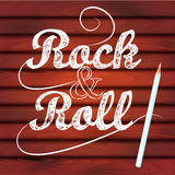 Rock n roll lettering, wood texture Royalty Free Stock Photo