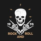 Rock-n-Roll music grunge typography for t-shirt. Clothes design with skeleton hands and skull. Graphics for clothes print, apparel royalty free stock photo