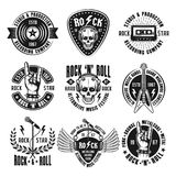 Rock n roll music vintage emblems, labels, badges. Rock n roll music set of vintage emblems, labels, badges and logos in monochrome style isolated on white stock illustration