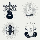 Rock-n-roll prints for t-shirt. Set of graphic design for clothes, t-shirt, apparel with guitar, lightning, ribbon, sunburst. Rock-n-roll prints for t-shirt Stock Photo