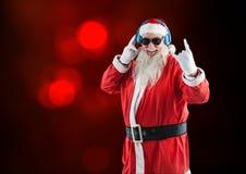 Rock n roll santa claus listening to music on headphones Stock Image