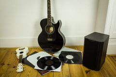 Rock'n'roll setup with ukulele, acoustic guitar, speaker and vin Royalty Free Stock Photography