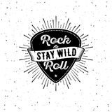 Rock n Roll white. Rock and Roll sign. Stay wild. Slogan graphic for t shirt. Poster with plectrum, ribbon, starburst vector illustration