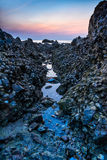 Rock narrow channel of the sea wave. Royalty Free Stock Images