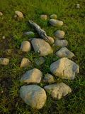 Rock on the natural grass wallpaper Royalty Free Stock Photos
