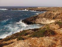 ROCK near sea of the LAMPEDUSA island in Italy. Clean sea of the LAMPEDUSA island in Italy stock photo