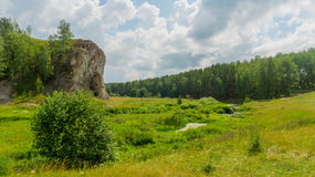 Rock near a stream in a sunny summer day Stock Image