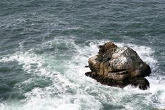 Rock in the ocean Royalty Free Stock Image