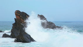 Rock in the Ocean and a Big Wave stock footage