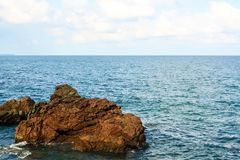 A rock in the ocean royalty free stock photography