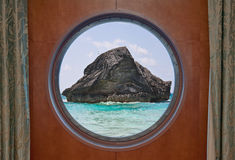 Rock in Ocean through Porthole Royalty Free Stock Photos