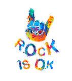 Rock is ok. Hand sign of horns. Rock is ok. Hand sign of the horns. Splash paint Stock Photo