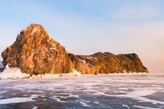 Rock over freeze water lake winter season. With clear blue sky background, Baikal Russia Stock Images