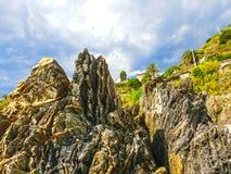 The rock over Mediterranean sea, Manarola, Cinque Terre, Italy Stock Photos
