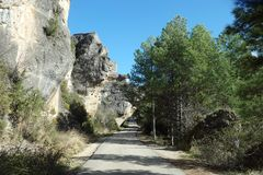 Rock covering small road to viewpoint of Cuenca town in Spain. Rock overhanging small road to mirador of old town stock image
