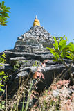 Rock pagoda. The beautiful old pagoda make from stone and rock on sunshine day with the blue sky Stock Photo