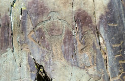 Rock painting. Made few thousand years ago. It depicts animals and humans Stock Photos