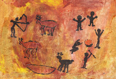 Rock paintings of people and animals Stock Photos