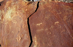 Rock paintings, Twyfelfontein, Namibia. Rock paintings in Twyfelfontein, Namibia have draws of different animals, like giraffe, elephant, rhino, even seal and Royalty Free Stock Photo