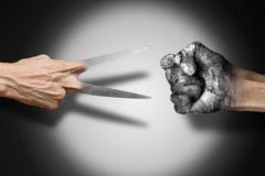 Rock Paper Scissors. Made out of the hand gestures corresponding to the materials of rock, paper and scissors Stock Photo