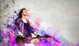 Rock passionate girl with black wings Royalty Free Stock Photography