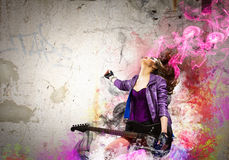 Rock passionate girl with black wings Royalty Free Stock Photo